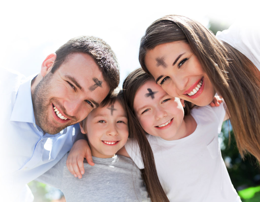 Family with ashes on their foreheads