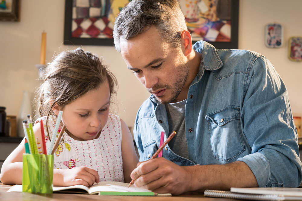 Dad helps daughter with homework